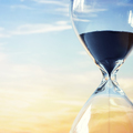 Hourglass at sunset with copy space